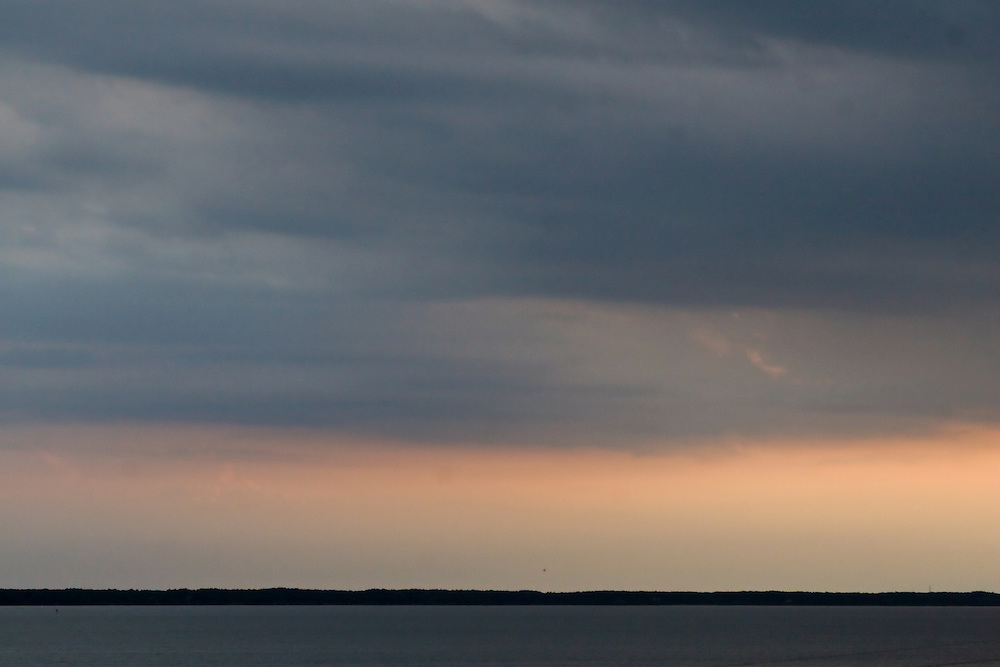 Calm bands of cloud, sky, and sea at Jockey's Ridge National State Park, North Carolina.