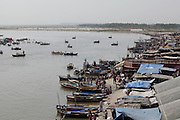 row boats on the Ganges River at the holy city of Garhmukteshwar, Uttar Pradesh, India