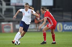 England Women's Jill Scott (left) and Wales Women's Kayleigh Green battle for the ball