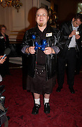 Craig Keith, fastest balloon done behind his back, 50th Anniversary Party of the Guinness Book of World Records, November 16, 2004 - The Royal Opera House London, Great Britain<br />ONE TIME USE ONLY - DO NOT ARCHIVE  © Copyright Photograph by Dafydd Jones 66 Stockwell Park Rd. London SW9 0DA Tel 020 7733 0108 www.dafjones.com