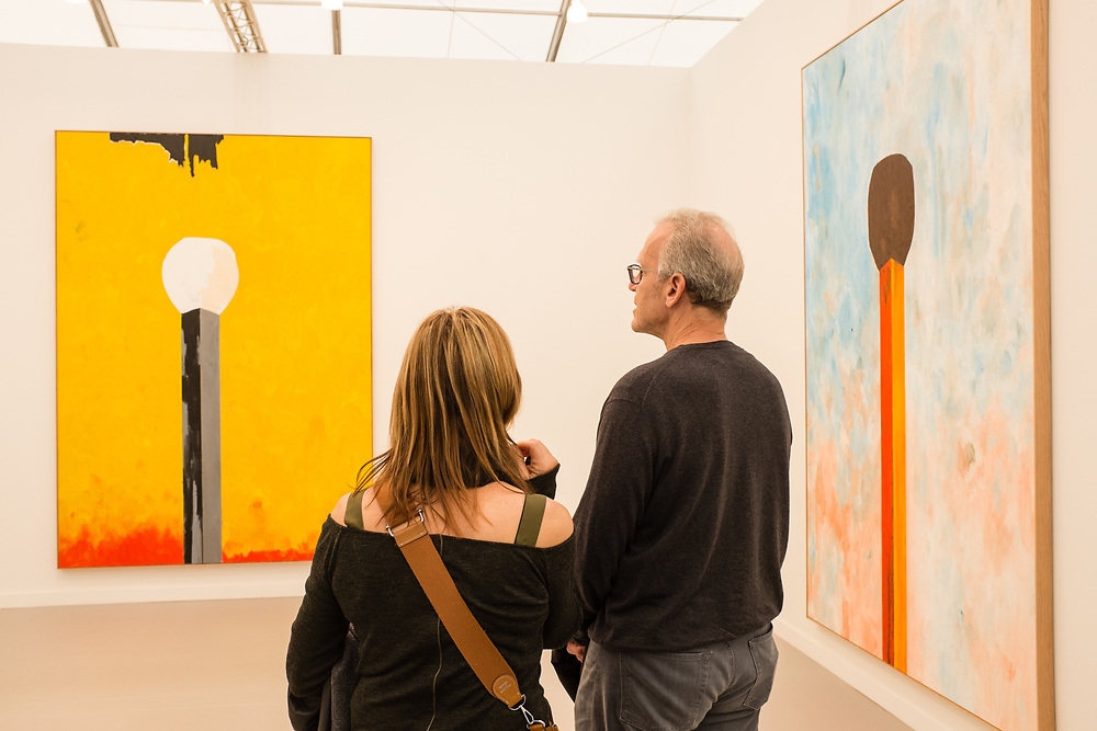 New York, NY - May 3, 2019. Spectators amid large paintings of matches by Harold Ancart in the David Zwirner Gallery at the Frieze Art Fair on New York City's Randalls Island.