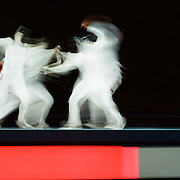 A panoramic view of fencers in action during the Athens 2004 Summer Olympic Games at the Olympic Stadium. Athens, Greece. 25th August 2004. Photo Tim Clayton.