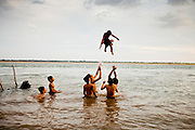 15 MARCH 2006 - PEAM CHIHYKAUNG, KAMPONG CHAM, CAMBODIA: Boys play in the Mekong River in the small village of  Peam Chihykaung in central Cambodia. Photo by Jack Kurtz / ZUMA Press