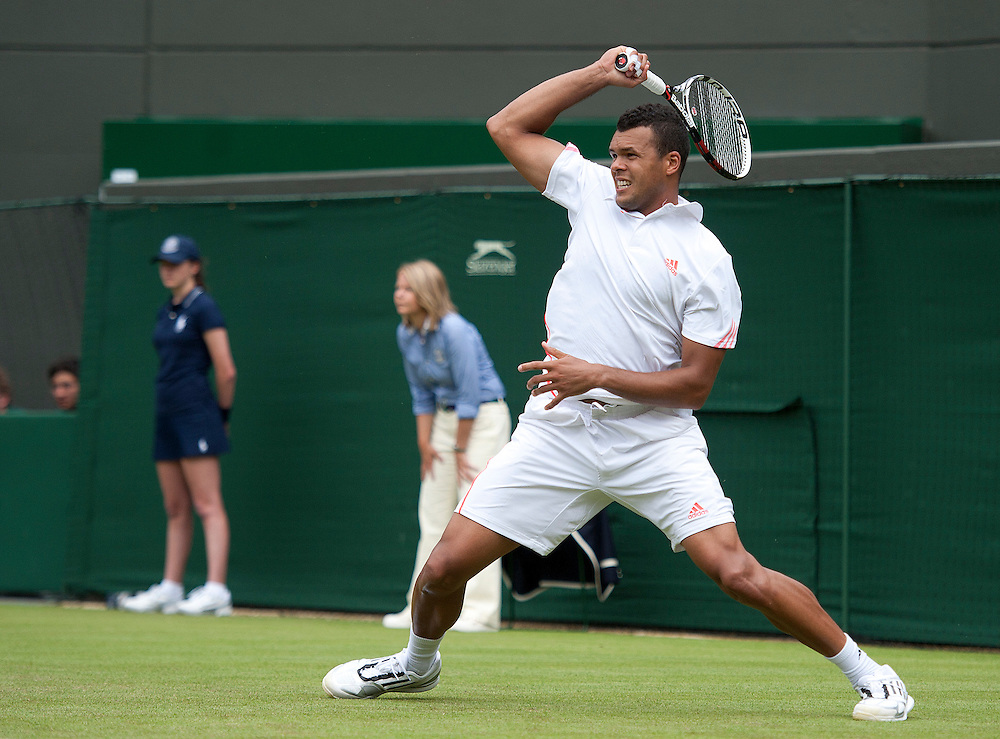 Jo-Wilfried Tsonga FRA (5) in action today during his victory over Lleyton Hewitt AUS in their Gentlemen's Singles First Round match..Tennis - Wimbledon Lawn Tennis Championships - Day 2 - Tuesday 26th June 2012 -  All England Lawn Tennis and Croquet Club - Wimbledon - London - England...