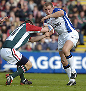 Leicester, England UK., 9th October 2004,  Zurich Premiership Rugby, Leicester Tigers vs Bath Rugby, Welford Road,<br /> [Mandatory Credit: Peter Spurrier/Intersport Images],<br /> <br /> Baths, Mike Tindall, running  through mid field brushes aside, Tigers Ross Broadfoot tackle.