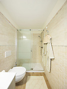 Modern bathroom with tiles. Large shower. Nobody inside