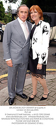 SIR JACKIE & LADY STEWART at a party in London on 3rd July 2003.<br /> PLC 64