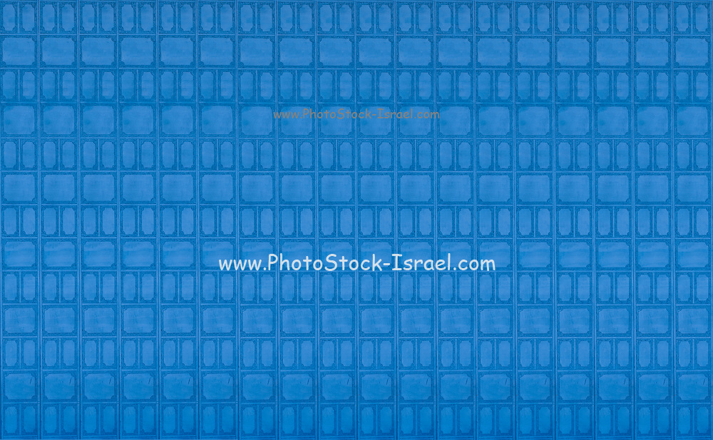 Digitally enhanced image of repeating wall decoration in blue