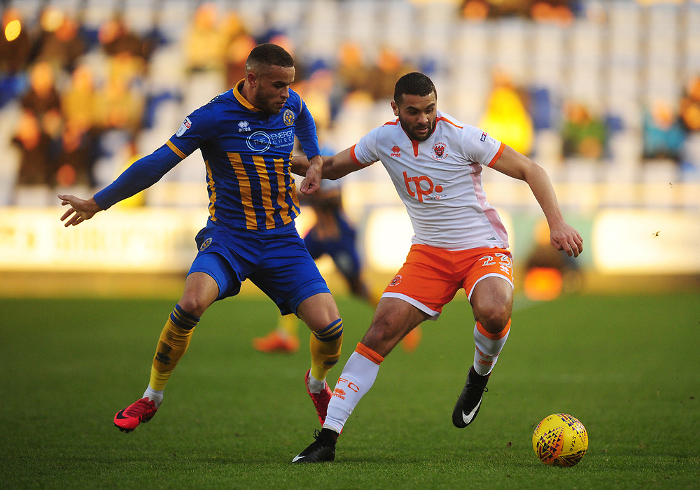 Blackpool's Colin Daniel under pressure from Shrewsbury Town's Carlton Morris<br /> <br /> Photographer Kevin Barnes/CameraSport<br /> <br /> The EFL Sky Bet League One - Shrewsbury Town v Blackpool - Saturday 16th December 2017 - New Meadow - Shrewsbury<br /> <br /> World Copyright © 2017 CameraSport. All rights reserved. 43 Linden Ave. Countesthorpe. Leicester. England. LE8 5PG - Tel: +44 (0) 116 277 4147 - admin@camerasport.com - www.camerasport.com