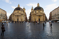 Rome Italy, Pedestrians walk on Piazza del Popolo, in front of the twin Twin churches Santa Maria dei Miracoli, right, and Santa Maria di Montesanto, left.
