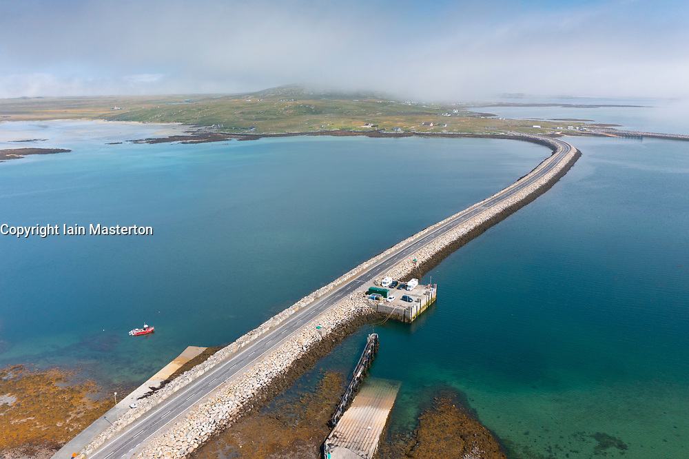 Aerial view from drone of Berneray causeway linking Berneray Island ( top) to North Uist the Outer Hebrides, Scotland, UK
