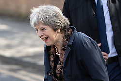 © Licensed to London News Pictures . 30/04/2018. Manchester , UK. British Prime Minister THERESA MAY crosses a road to meet local residents after visiting Brooklands Primary School in Sale . May is facing questions over her role in the scandal of the way Windrush migrants have been treated and after the resignation of Home Secretary, Amber Rudd, late last night (29 April 2018) . Photo credit : Joel Goodman/LNP