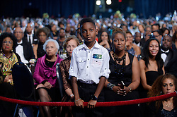 A young boy listens to U.S. President Barack Obama as he speaks to the Congressional Black Caucus Foundation's 46th Annual Legislative Conference Phoenix Awards Dinner, September 17 2016, in Washington, DC, USA. Photo by Olivier Douliery/Pool/ABACAPRESS.COM