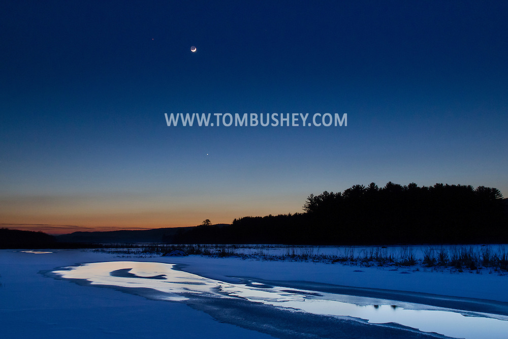 Mamakating, New York - The crescent moon shines in the sky over the Bashakill Wildlife Management Area after sunset on Jan. 22, 2015.