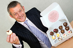 """Atteys Solicitor Steve Taylor with the Atteys """"Sweet Taste Of Scucess"""" Cup Cakes..7th September2011 Image © Paul David Drabble"""