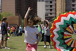 Stock photo of young kids running with parachutes