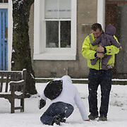 Woman after a fall in snow, Musselburgh, East Lothian, Scotland<br />