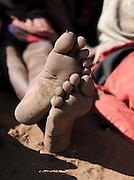 Maasai tribeswomans bare feet, Oyaratta village near Maasai Mara National Reserve, Kenya
