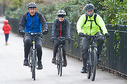 © Licensed to London News Pictures 08/04/2021.<br /> Greenwich, UK. Three cyclists in the park together. People out and about in Greenwich Park, London as coronavirus lockdown restrictions continue to ease in the UK. Photo credit:Grant Falvey/LNP
