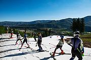 AVSC FIS alpine athletes line up at the top of the course during the first week of Buttermilk Glacier in Aspen, Colorado.