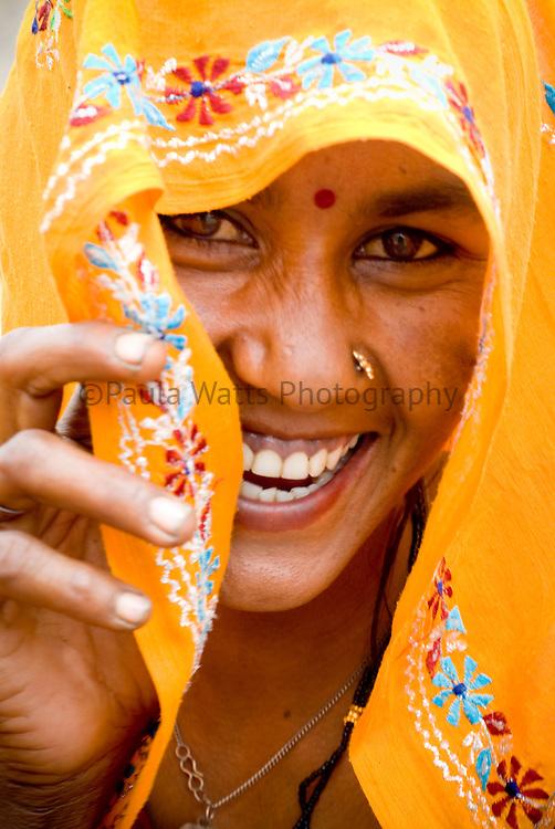 Friendly Jaipur Indian woman in yellow orange saree