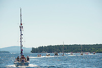 Dozens of boats join in for the Winnipesaukee Yacht Club's 4th of July boat parade coming out from Saunders Bay on Monday morning.  (Karen Bobotas/for the Laconia Daily Sun)