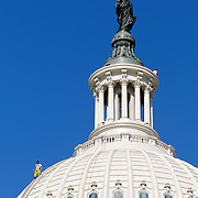 Workers in yellow overalls clean the US Capitol Dome in Washington Dc