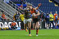 James Clare of Castleford Tigers makes a break  during the Betfred Super League match between Leeds Rhinos and Castleford Tigers at Emerald Headingley Stadium, Leeds, United Kingdom on 26 October 2020.