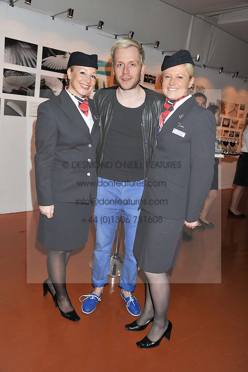 MR HUDSON and BA flight attendants Left to right, JULIA DRIFFIELD and JO FORBES at the launch of Flight BA2012 - an evening of Art, Food and Film to see Olympic Games inspires work by rising British Talent held at BA's pop up venue at 3-10 Shoreditch High Street, London E1 on 3rd April 2012.