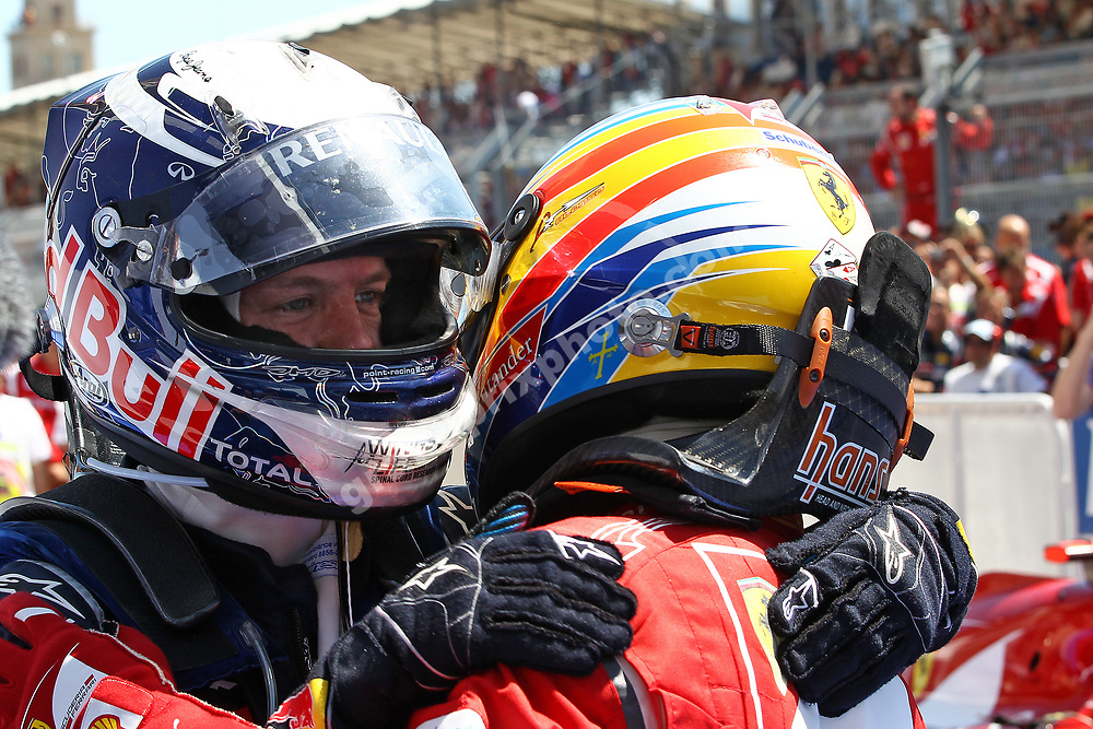 Sebastian Vettel (Red Bull-Renault) and Fernando Alonso (Ferrari) after the 2011 European Grand Prix in Valencia. Photo: Grand Prix Photo