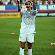 U.S. goalkeeper Hope Solo (1) looks at cheering fans after an international friendly soccer match between the United States Women's National soccer team and the Russia National soccer team at FAU Stadium on Saturday, February 8, in Boca Raton, Florida. The U.S. won the match by a score of 7-0. (AP Photo/Alex Menendez)