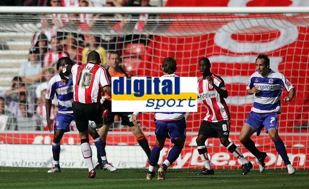 Photo: Lee Earle.<br /> Southampton v Queens Park Rangers. Coca Cola Championship. 30/09/2006. Southampton's Jermaine Wright (2ndL) beats QPR keeper Paul Jones to open the scoring.