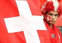 GEPA-1106086005 - BASEL,SCHWEIZ,11.JUN.08 - FUSSBALL - UEFA Europameisterschaft, EURO 2008, Schweiz vs Tuerkei, SUI vs TUR, Vorberichte. Bild zeigt einen Fan der Schweiz. Keywords: Fahne, Flagge.<br />Foto: GEPA pictures/ Philipp Schalber
