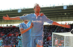 Stoke City's Peter Crouch celebrates scoring his side's first goal of the game during the Premier League match at St Mary's Stadium, Southampton.