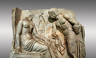 """Close up of a Roman Sebasteion relief  sculpture of Io and Argos Aphrodisias Museum, Aphrodisias, Turkey. <br /> <br /> A powerful hero is folding a sword gazing closely at a half naked and dishevelled young heroine who sits on a chest like stool. Between, on a pillar base stood a small, separately added statue of a goddess ( now missing). The scene follows a scheme used in the relief panels """"Io guarded by Argos"""". Io was one of Zeus's lovers, and Argos was a watchful giant sent to guard her by Hera, Zeus's wife. .<br /> <br /> If you prefer to buy from our ALAMY STOCK LIBRARY page at https://www.alamy.com/portfolio/paul-williams-funkystock/greco-roman-sculptures.html . Type -    Aphrodisias     - into LOWER SEARCH WITHIN GALLERY box - Refine search by adding a subject, place, background colour, museum etc.<br /> <br /> Visit our ROMAN WORLD PHOTO COLLECTIONS for more photos to download or buy as wall art prints https://funkystock.photoshelter.com/gallery-collection/The-Romans-Art-Artefacts-Antiquities-Historic-Sites-Pictures-Images/C0000r2uLJJo9_s0"""