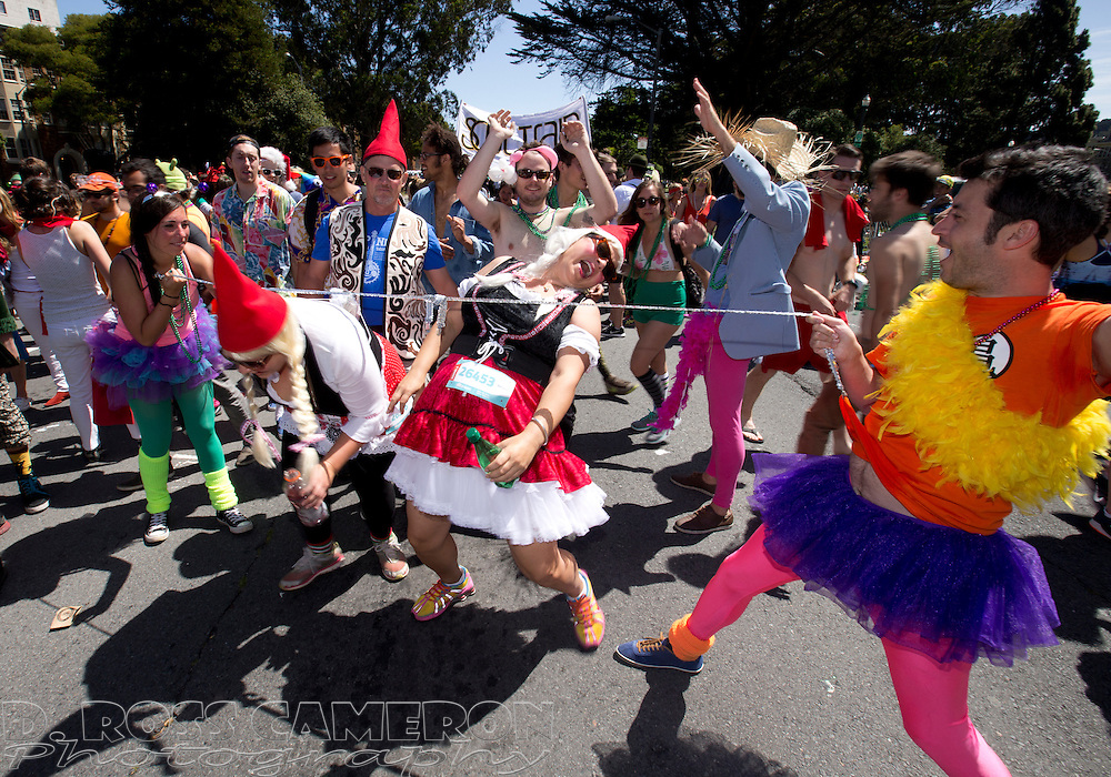 Participants in the 103rd running of the Bay to Breakers 12K race set up an impromptu limbo dance on Fell Street, Sunday, May 18, 2014 in San Francisco. Tens of thousands of runners -- from the elite athletes to weekend warriors to those who simply wanted a walk in the park -- traversed the course from the San Francisco Bay to the Pacific Ocean. (Photo by D. Ross Cameron)