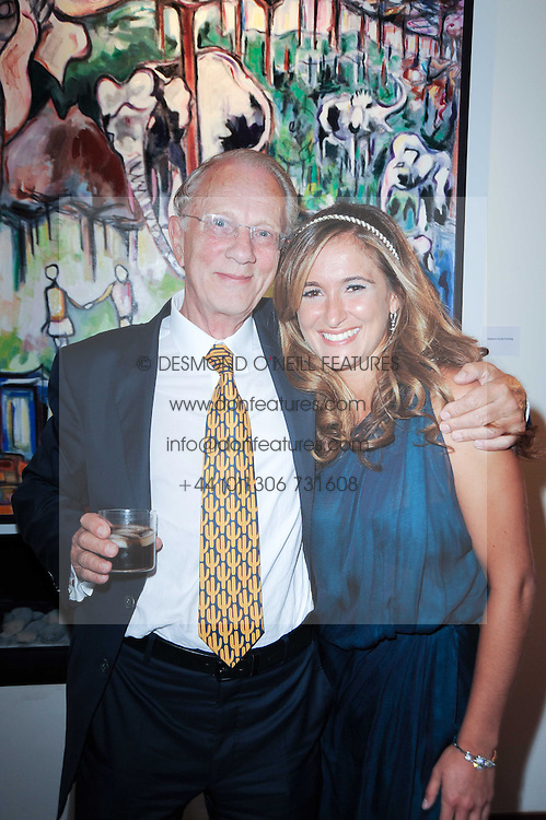 JAN MOL and TANAZ DIZADJI at a private view of Sacha Jafri's paintings entitled 'London to India' held in aid of The Elephant Family charity at 23 Macklin Street, Covent Garden, London on 3rd June 2010.