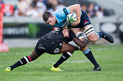 Durban. 030318. Lwazi Mvovo of the Cell C Sharks looks to stop Jed Halloway of the Waratahs  during the Super Rugby match between Cell C Sharks and Waratahs at Kings Park on March 03, 2018 in Durban, South Africa. Picture Leon Lestrade/African News Agency/ANA