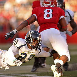 Sep 19, 2009; Piscataway, NJ, USA; Florida International cornerback Dezariah Johnson (29) misses a tackle on Rutgers running back Kordell Young (8) during the first half of NCAA college football between Rutgers and Florida International at Rutgers Stadium.