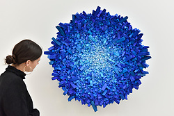 """© Licensed to London News Pictures. 13/09/2017. London, UK. A woman views """"Aggregation 17 AP031 (Star7)"""", 2017, by Kwang Young Chun. Preview of the START Art Fair at the Saatchi Gallery in Chelsea.  The fair showcases the best emerging artists from developing markets across the globe and is open to the public 14 to 17 September. Photo credit : Stephen Chung/LNP"""