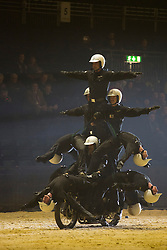 © Licensed to London News Pictures. 06/12/2013. London, England. The Royal Signals' White Helmets, motorbike display team. The 2013 British Military Tournament is one of the largest displays of military theatre in the world and takes place at Earls Court from 7-8 December 2013. Photo credit: Bettina Strenske/LNP