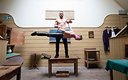 """Head First Acrobats experiment at the Old Operating Theatre Museum ahead of their performances of Elixir at the Underbelly Festival.<br /><br />Thomas Gorham,  Rowan Thomas <br /><br />Head First Acrobats ()who won the Best Circus and Physical Theatre Award show off their incredible circus skills at the Old Operating Theatre Museum, London, Great Britain <br />7th June 2018 <br /><br />Their show """"Elixir"""" is part of the Underbelly Festival from Tuesday 12th June. <br /><br />When three gleefully inept scientists attempt to produce the Elixir of Life, chaos erupts in the laboratory. Tumbling on the spinning Cyr wheel, handstanding on tottering ladders, balancing on their heads on a swinging trapeze, the Head First Acrobats' bring their signature mix of comedy caper and incredible acrobatic talent to the Southbank.<br /> <br />Photograph by Elliott Franks"""