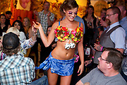 PRICE CHAMBERS / NEWS&GUIDEThea Sutton gives the audience a good show as she models the Pair-A-Dice bra decorated by Kim Kerr of Stitch 'N Time, sponsored by Farm Bureau Financial Services on Saturday night at Bra's for a Cause. The bra sold for $650.