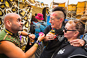Glastonbury Festival, 2015. Shangri La is a festival of contemporary performing arts held each year within Glastonbury Festival. The theme for the 2015 Shangri La was Protest. Staff at the Gorilla bar and performers celebrating into the dawn.