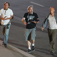 US actor Bruce Willis (R) walks along with members of the crew on set during a shooting of their next movie fifth in the Die Hard series titled Good Day to Die Hard in Budapest, Hungary on July 11, 2012. ATTILA VOLGYI