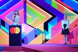 Taylor Swift accepts the Global Icon award as Maisie Williams looks on during the Brit Awards 2021 at the O2 Arena, London. Picture date: Tuesday May 11, 2021.