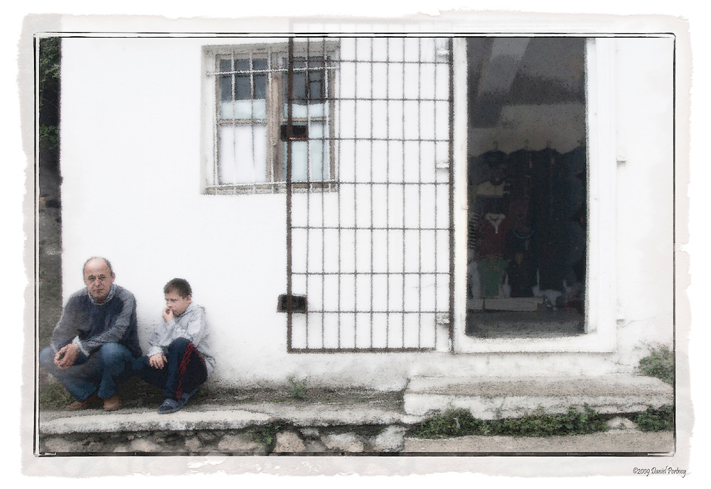 Shopowner and son waiting for customers in Kruja Albania