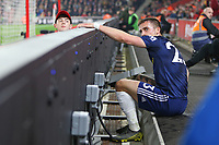 Football - 2018 / 2019 Premier League - Southampton vs. Fulham<br /> <br /> A Southampton ball boy checks on Joe Bryan of Fulham after the Fulham player takes a tumble over the advertising boards at St Mary's Stadium Southampton<br /> <br /> COLORSPORT/SHAUN BOGGUST