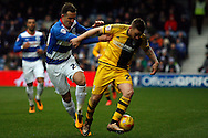 Jamie O'Hara of Fulham in possession whilst under pressure from QPR's Daniel Tozser.  Skybet football league championship match, Queens Park Rangers v Fulham at Loftus Road Stadium in London on Saturday 13th February 2016.<br /> pic by Steffan Bowen, Andrew Orchard sports photography.