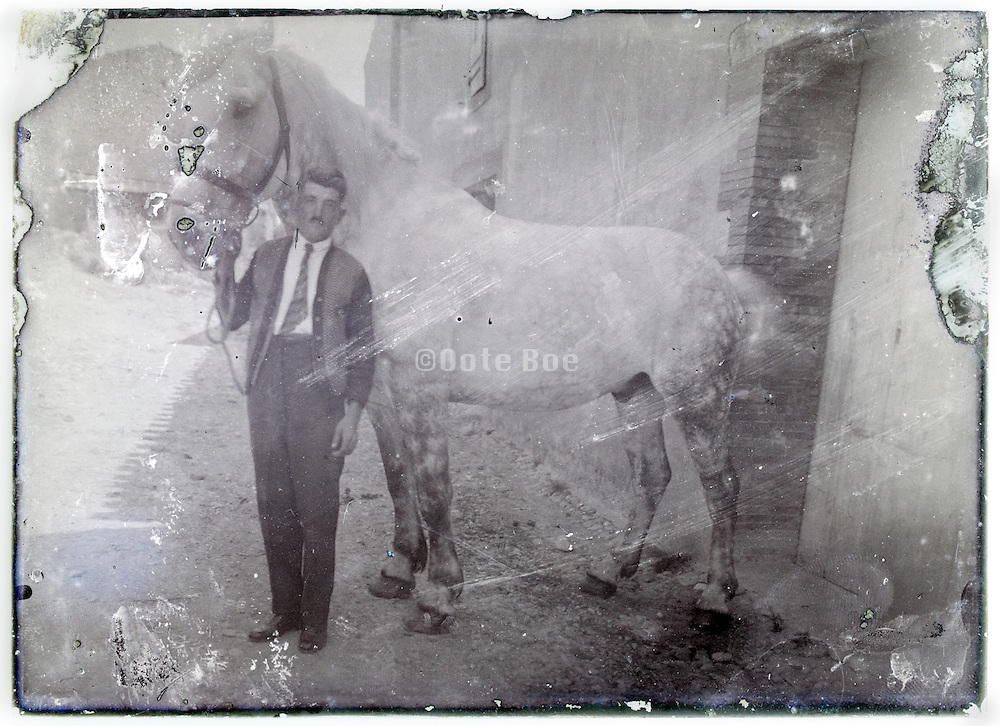 eroding glass plate with farmer and horse